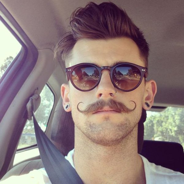 2. A curled mustache with the most genuine hipster style