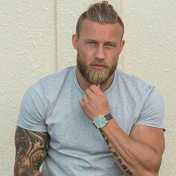2. High strip of long hair and faded sides, with a medium beard