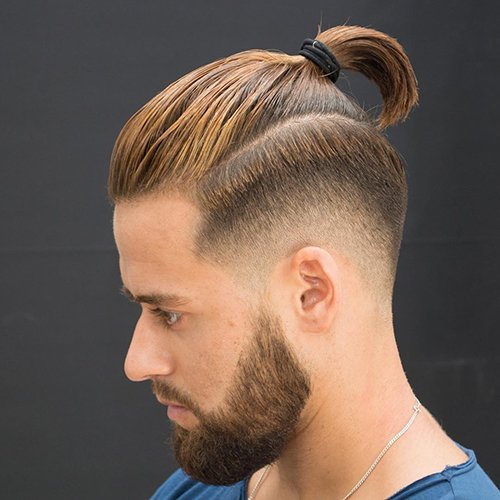 9 - Low fade haircut with beard and ponytail